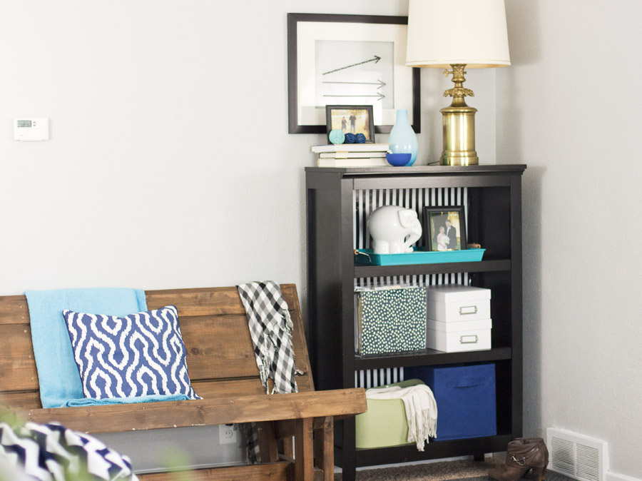Love this bookshelf! Easily update with striped wallpaper. Now I know how to style a bookshelf!