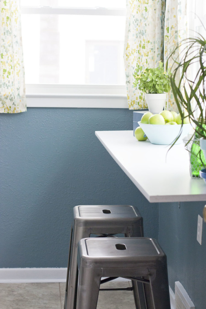 This happy kitchen is full of whites, blues and greens. Shows even small kitchens can look pretty!