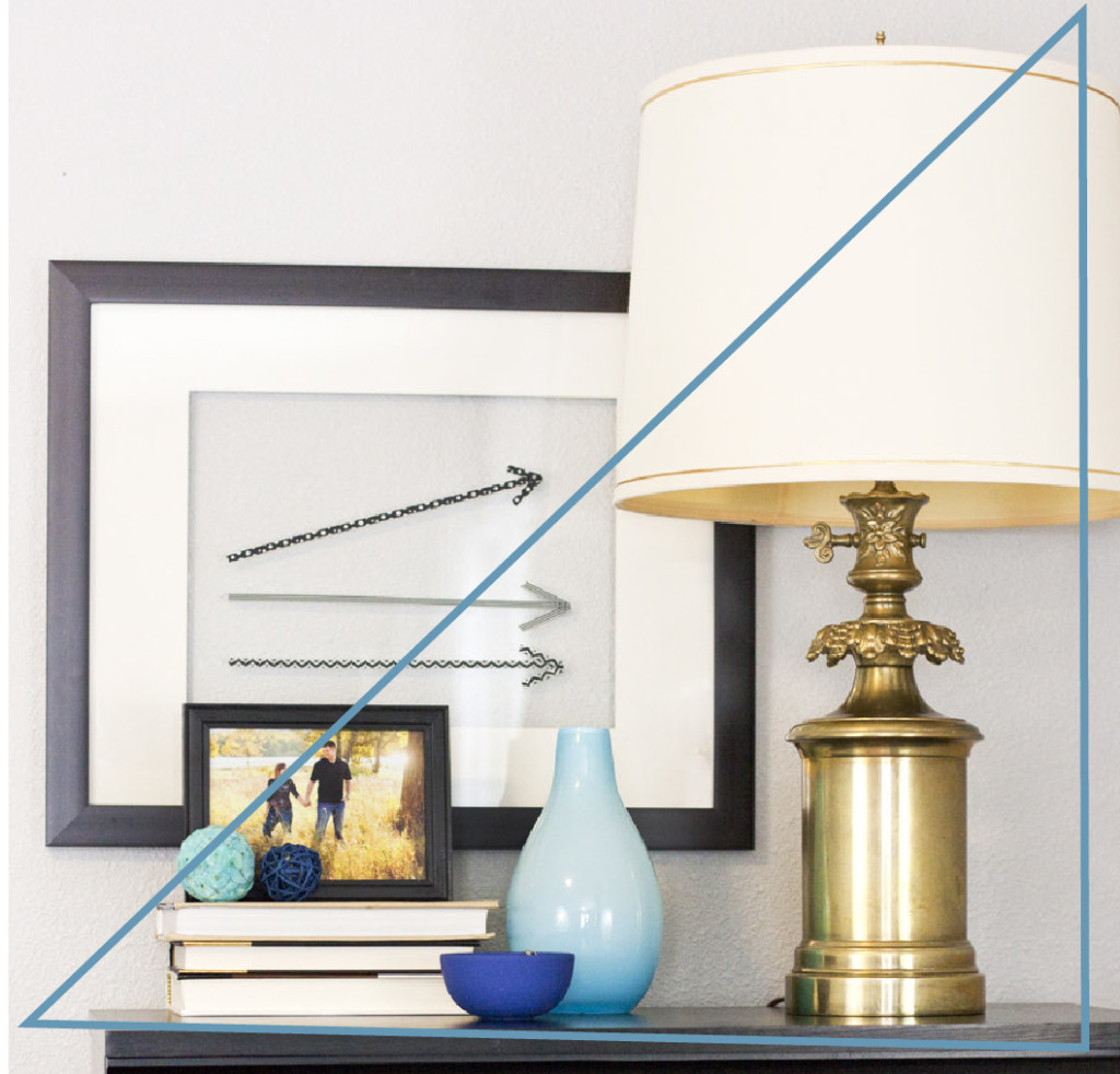 Good advice for styling a bookshelf using triangles.