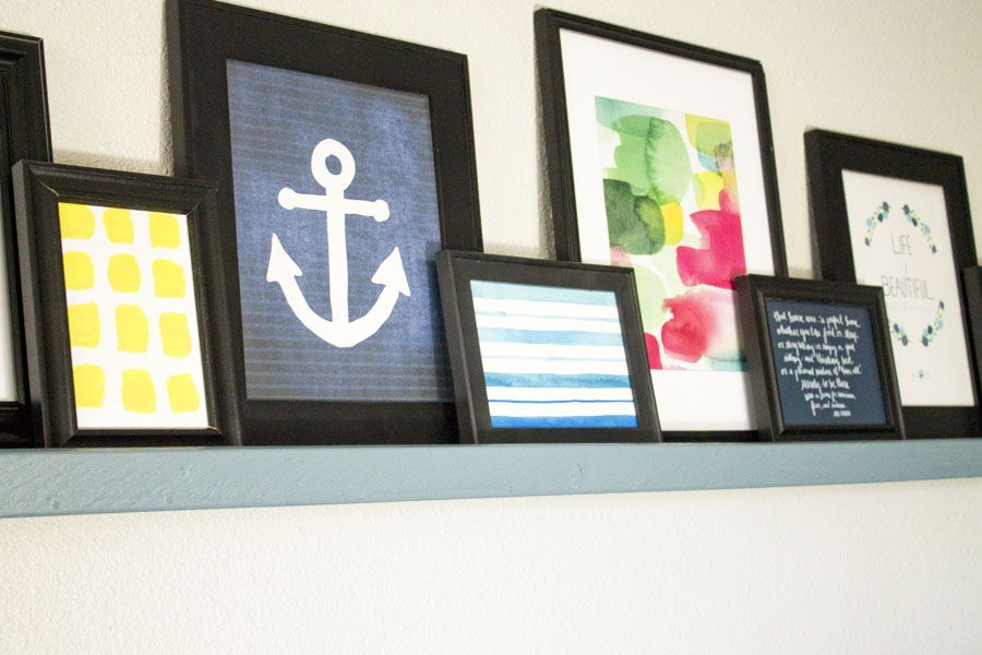 This picture ledge looks way easy to DIY. I'd love to have a place to display photo frames and art in our living room.