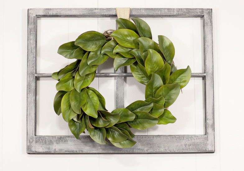 What a gorgeous but thrifty diy magnolia wreath. It looks beautiful hanging on that vintage window.