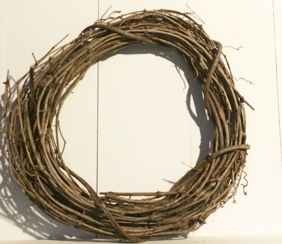 It's amazing that you can make a beautiful magnolia wreath out of a boring thrift store find.