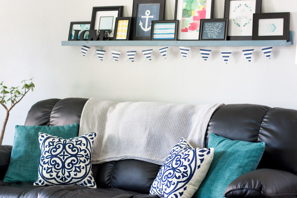 This living room looks so pretty! Love all of those blue pillows and that picture ledge/gallery wall.