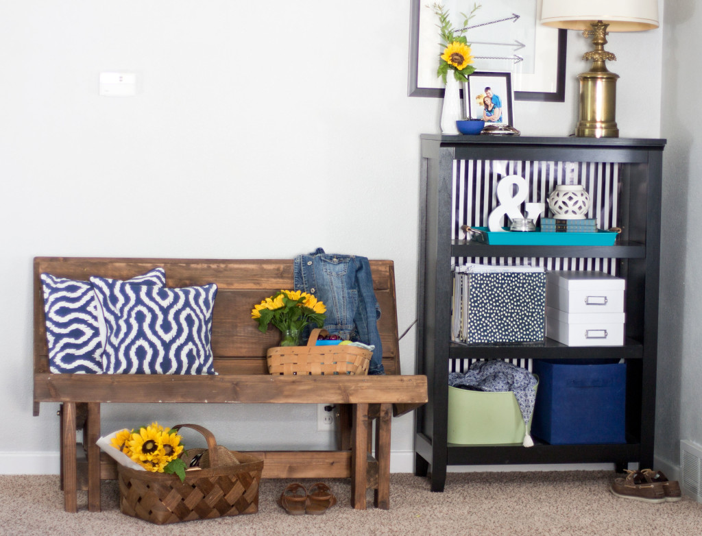 This summer bench and bookshelf look cute and organized. Love this white and blue home tour!