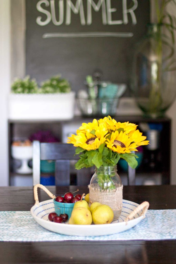 Check out this beautiful dining room sunflower centerpiece. And that big chalkboard in the background is so neat!
