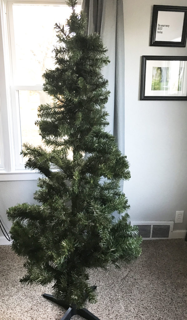 You'll never believe what this tree looks like after she finished decorating it! What a genius hack to fluff up and makeover your scraggly tree on a budget. Check out her tips for decorating a Christmas tree.