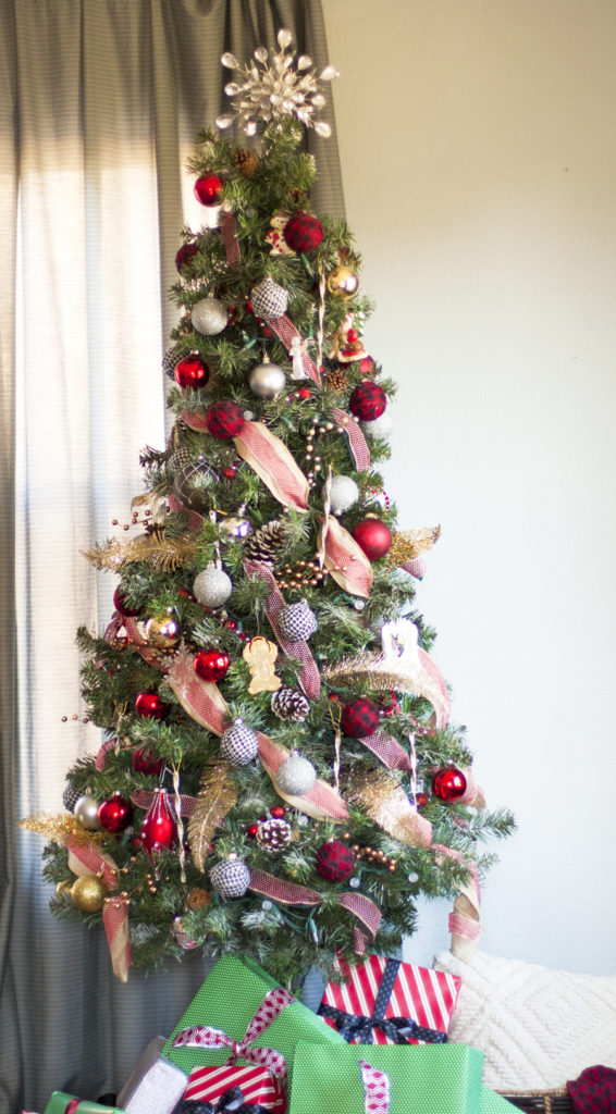 You have to check out what this Christmas tree looked like before she decorated it! Wow! What a genius hack to fluff up and makeover your scraggly tree on a budget. Check out her tips for decorating a Christmas tree.