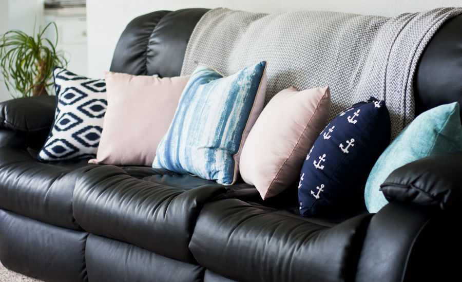This spring living room is beautiful! Love the pink, aqua and navy throw pillows and that painted TV stand. Simple spring decor   spring family room   blue decor   living room decor