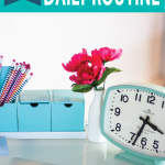 clock-and-flowers-on-desk