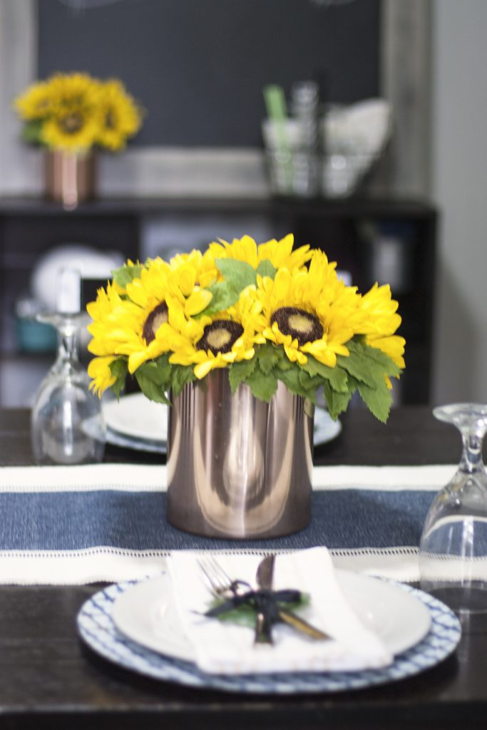 Love this simple summer tablescape! Sunflower centerpiece, simple table setting and easy dining room decor.