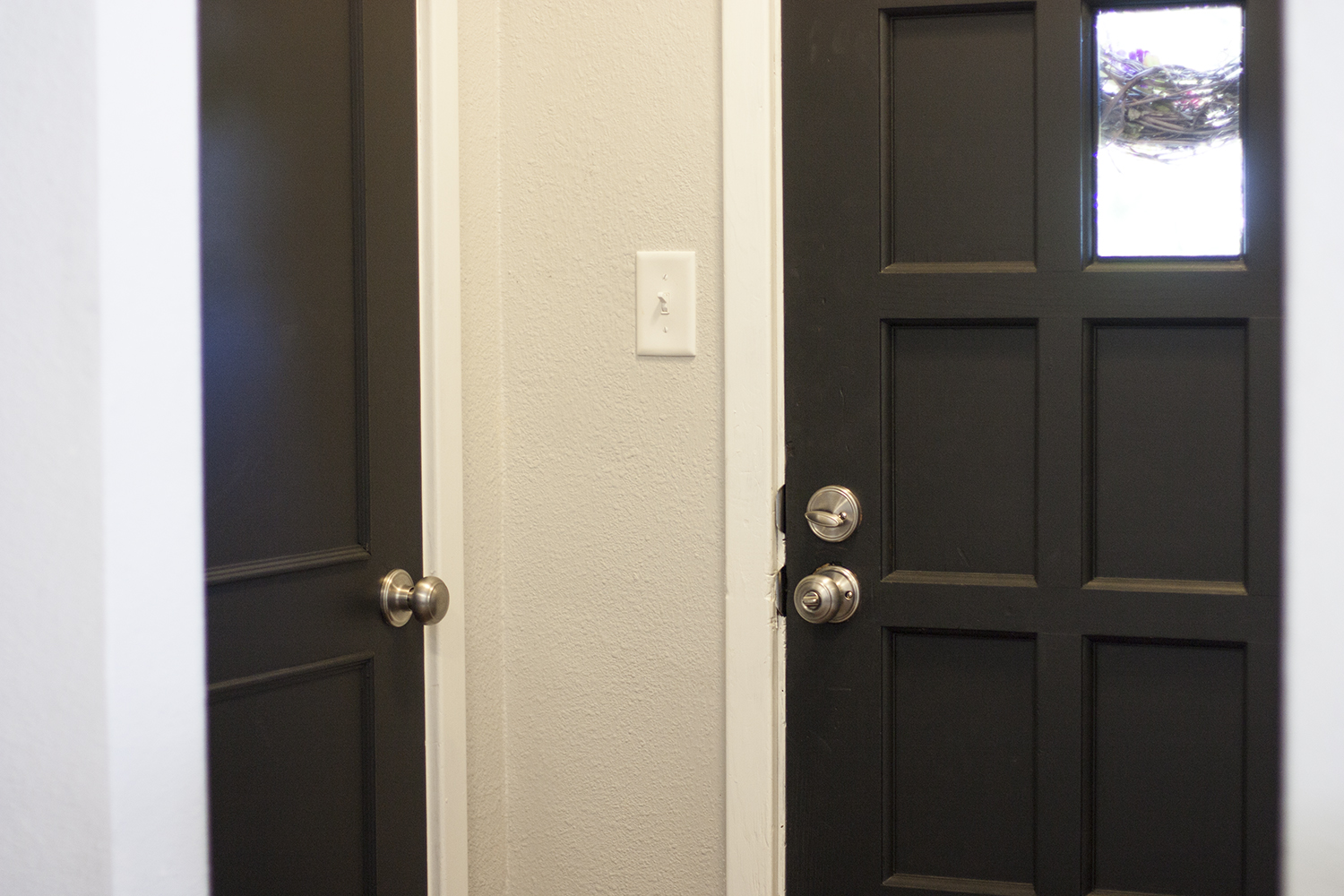 Painting interior doors black adding new hardware for Black interior paint