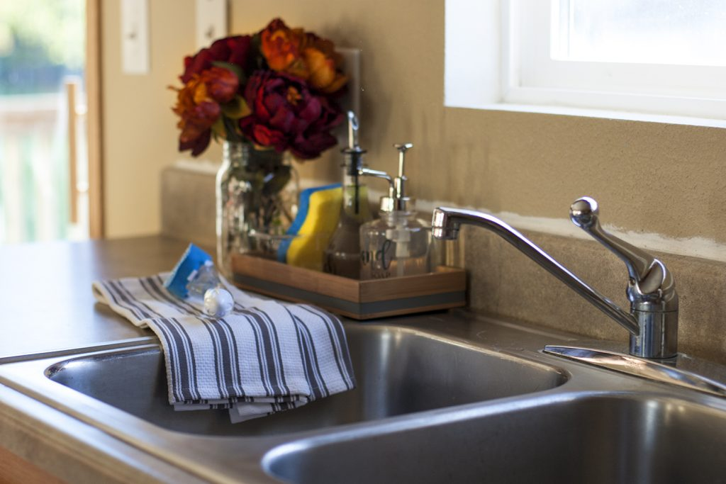 Making cleanup fast with an organized kitchen sink diy soap dispenser check out this pretty organized kitchen sink love the idea of a sink workwithnaturefo