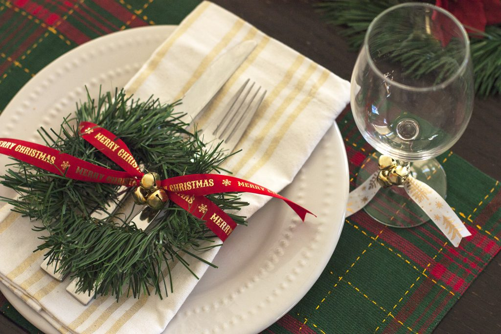 This classic plaid Christmas tablescape is made up of dollar store supplies! Love these cheap Christmas table decorations – all the red and green is so festive! Christmas tablescape ideas using Dollar Tree supplies.