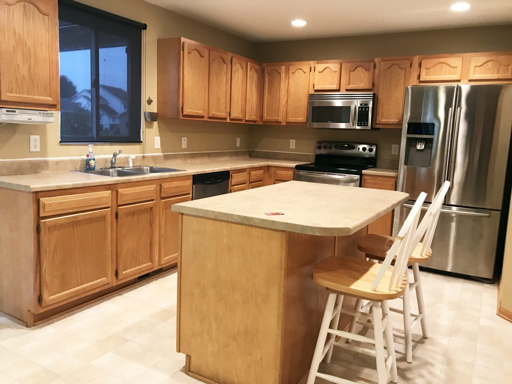 Our family recently bought a pretty gray house in the suburbs. Here are the before photos and all of our plans to turn this house into a home!