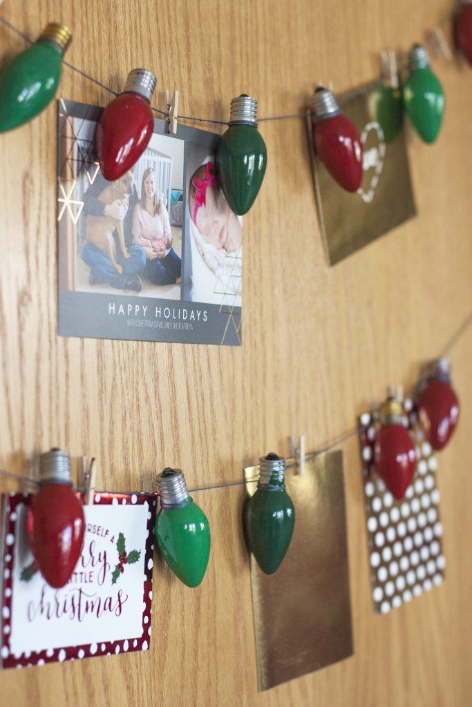 This hanging Christmas card display is so fun and simple! Love how she hung it on the door. #DecoArtProjects #ChristmasCards #ChristmasCardDisplay #Christmas #ChristmasDecor #DIYChristmas
