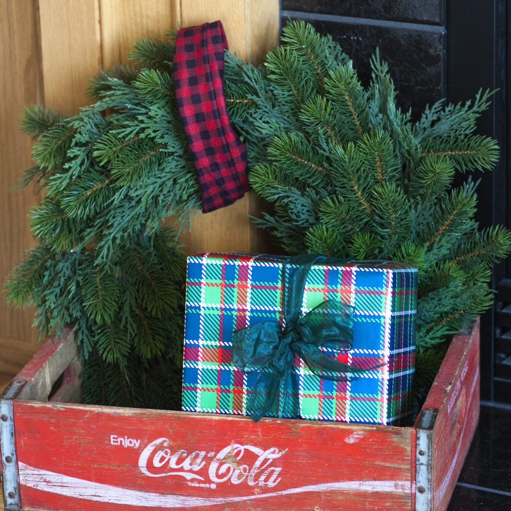 What a cute Christmas vignette! Great styling idea to put a wreath and wrapped present inside a wood crate for Christmas decor. christmas home tour | holiday homes | christmas house | christmas tree pictures | christmas mantel | christmas living room | christmas blog home tour