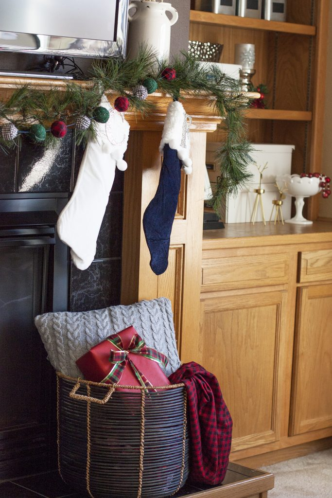 A pretty Christmas mantel with stockings and a DIY garland. christmas home tour | holiday homes | christmas house | christmas tree pictures | christmas mantel | christmas living room | christmas blog home tour christmas home tour | holiday homes | christmas house | christmas tree pictures | christmas mantel | christmas living room | christmas blog home tour