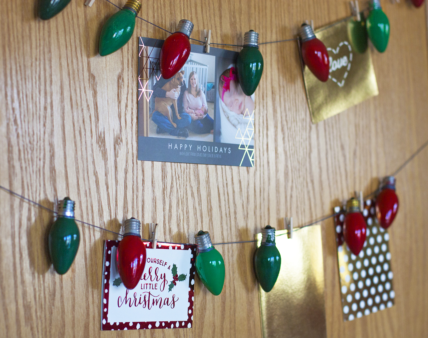 What a simple and adorable Christmas card display idea. How cute are those painted light bulbs?! This is a great way to hang up Christmas cards. #DecoArtProjects #ChristmasCards #ChristmasCardDisplay #Christmas #ChristmasDecor #DIYChristmas