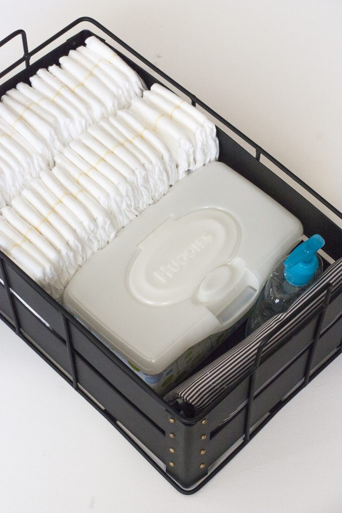 This is such a smart idea for organizing diapers! I love the idea of creating a DIY diaper caddy using any pretty basket or bin I have around the house. That makes it storage that's functional and pretty! Baby Tips | Nursery Organization | Diaper Caddy | Huggies | DIY Diaper Organizer | Diaper Organizing | Nursery Decor | Baby Essentials | Nursery Essentials