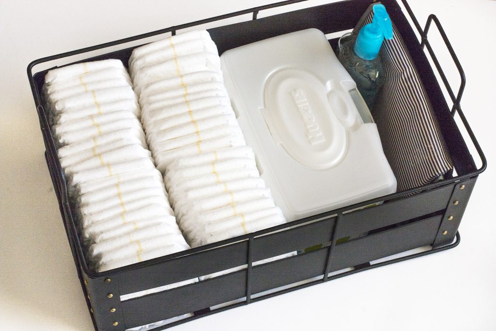 This is such a smart idea for organizing diapers! I love the idea of creating a DIY diaper caddy using any pretty basket or bin I have around the house. That makes it storage that's functional and pretty! Baby Tips   Nursery Organization   Diaper Caddy   Huggies   DIY Diaper Organizer   Diaper Organizing   Nursery Decor   Baby Essentials   Nursery Essentials