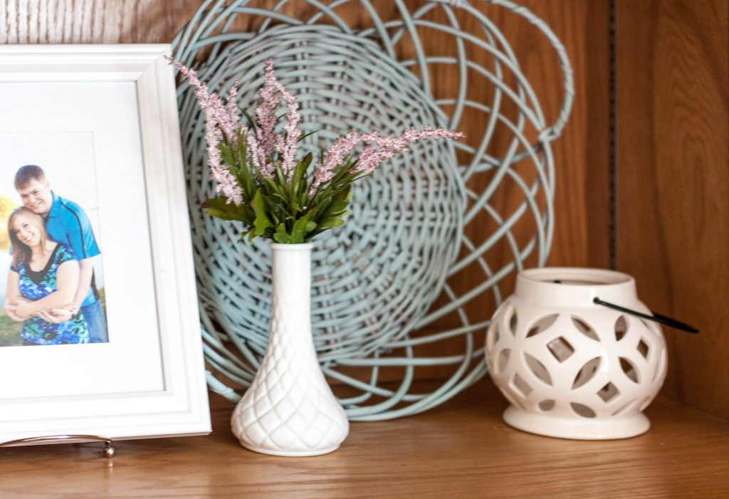blue-basket-and-flowers-on-shelf