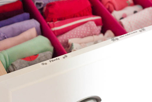 organized nursery dresser drawer with label
