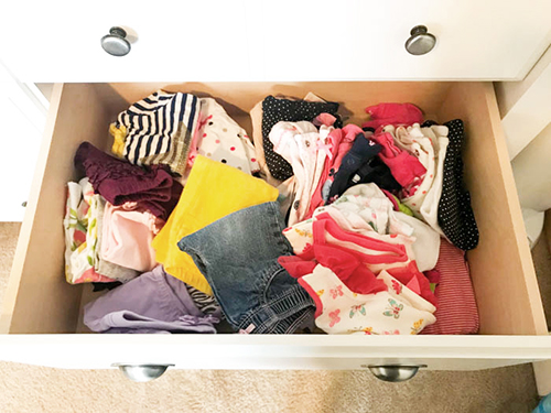 Messy Unorganized Baby Clothes In A Dresser Drawer