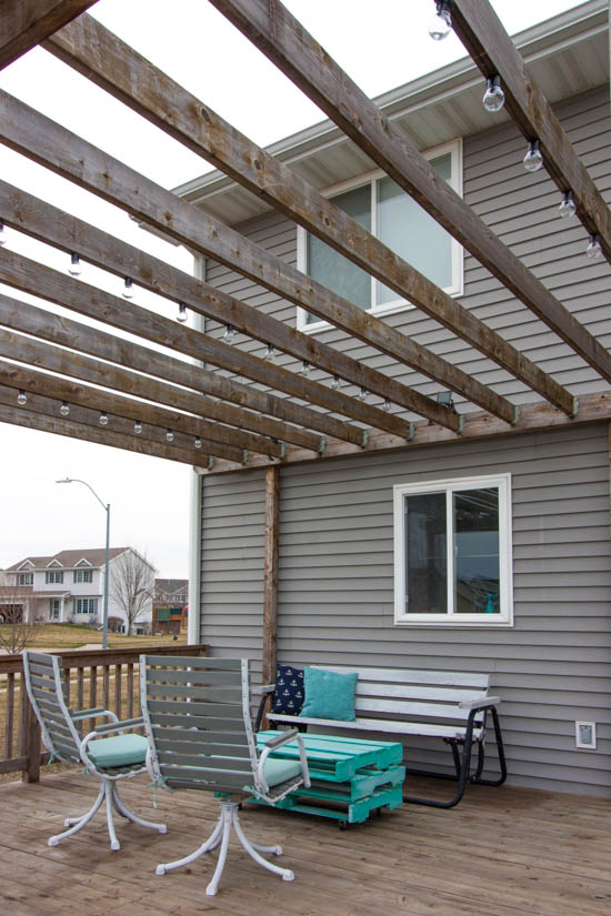 big-deck-with-pergola-and-hanging-solar-lights