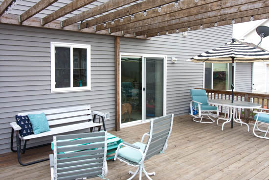 solar-deck-lights-on-pergola-with-aqua-patio-furniture