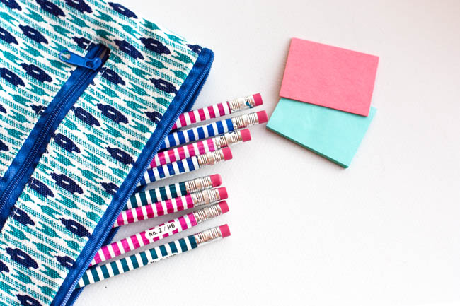 Blue Pencil Case With Blue And Pink Pencils Sticking Out
