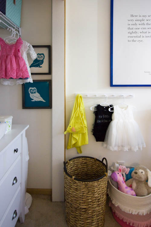 organized-nursery-with-changing-table-and-hooks
