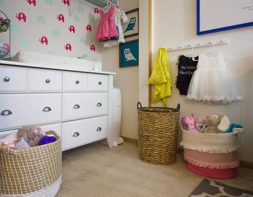 white-dresser-and-storage-baskets-in-organized-nursery