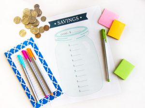 savings-tracker-printable-on-table
