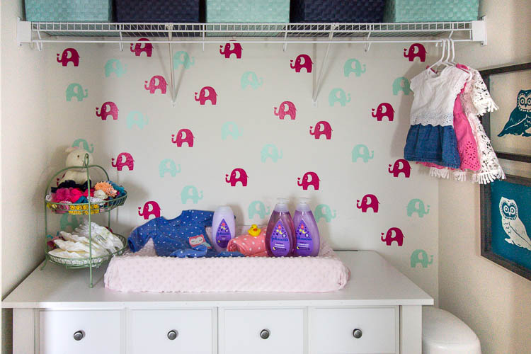 colorful-organized-nursery-with-elephant-wallpaper