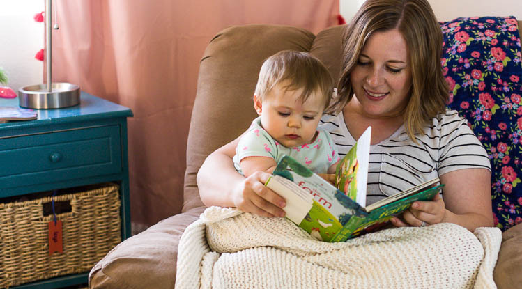 mom-reading-story-to-baby-in-the-evening