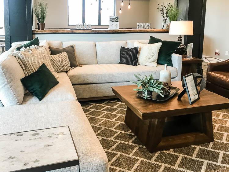 white-sofa-with-green-pillows