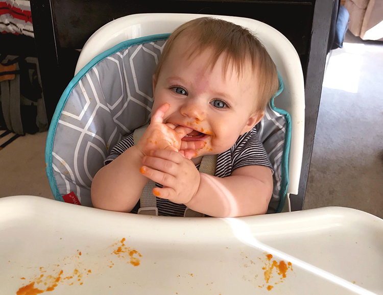baby-eating-food-in-high-chair
