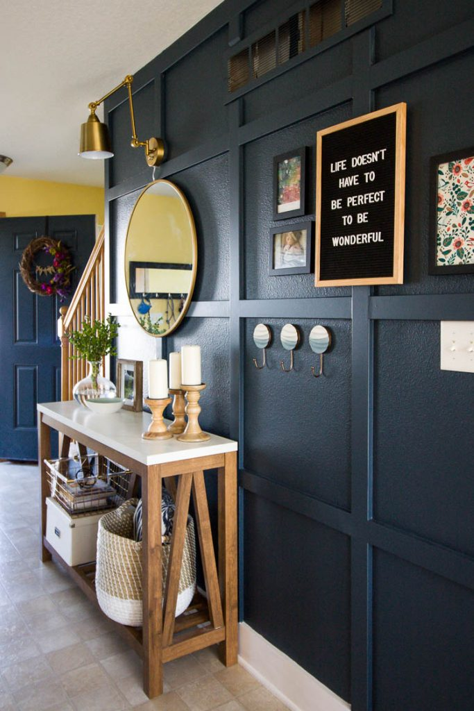 navy-entryway-wall-with-letterboard-and-console-table