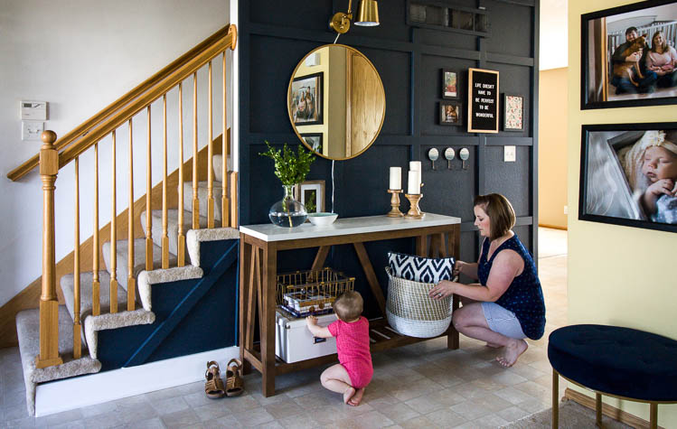 mom-and-baby-organizing-their-entryway
