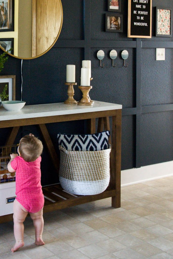 organized-entryway-with-navy-wall