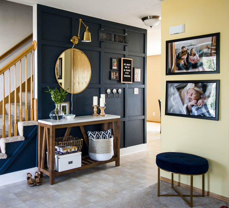 organized-entryway-with-blue-stool-and-wooden-console-table