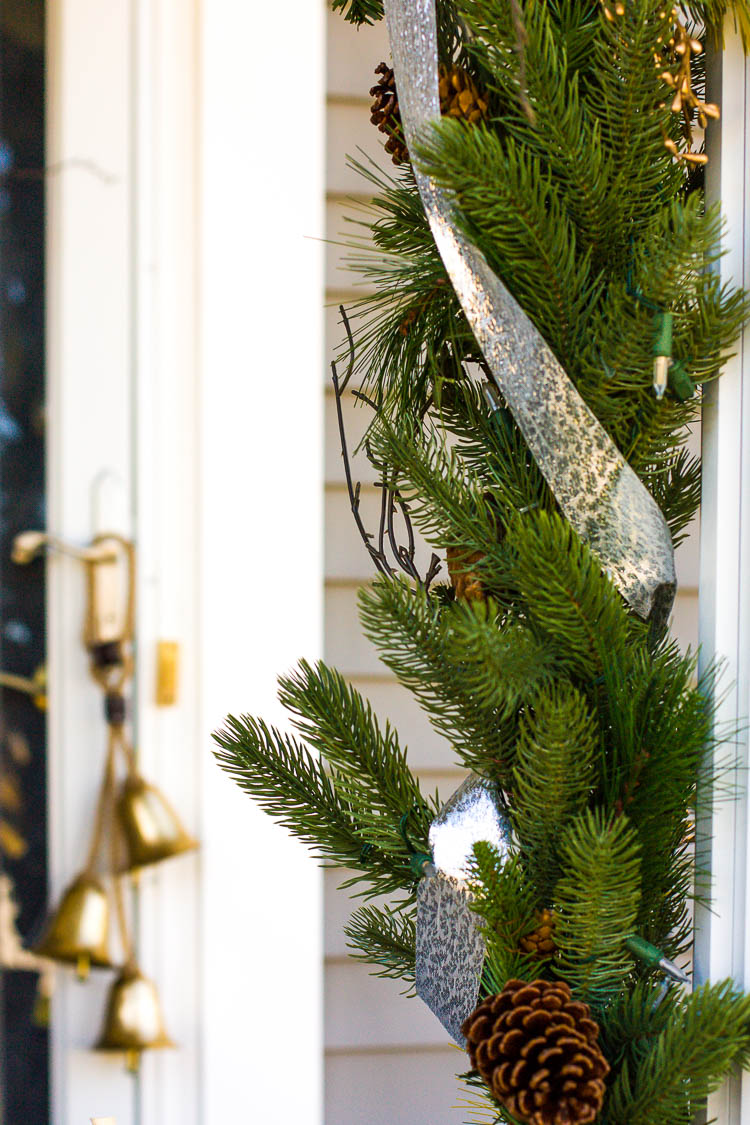 greenery-garland-on-porch-for-christmas