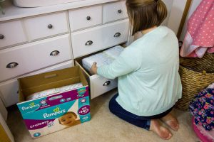 organizing-nursery-dresser-and-stocking-pampers-diapers