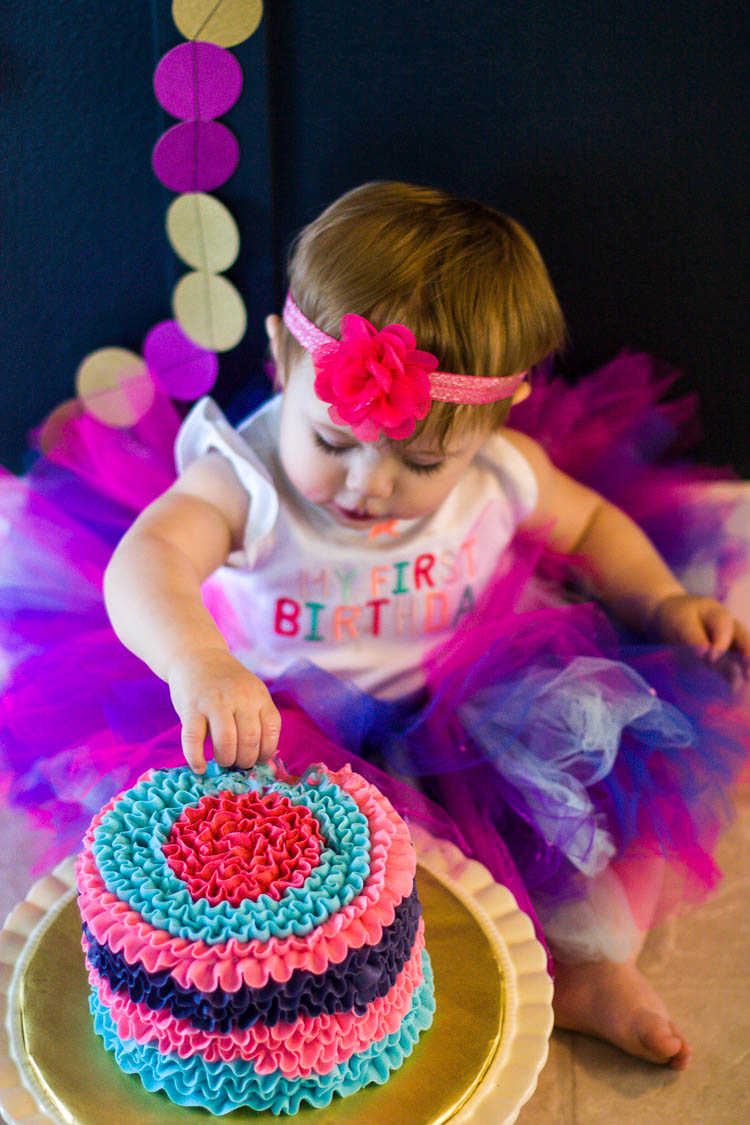 girl-in-colorful-tutu-eating-birthday-cake