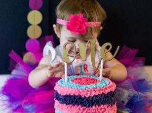 baby-girl-with-colorful-smash-cake