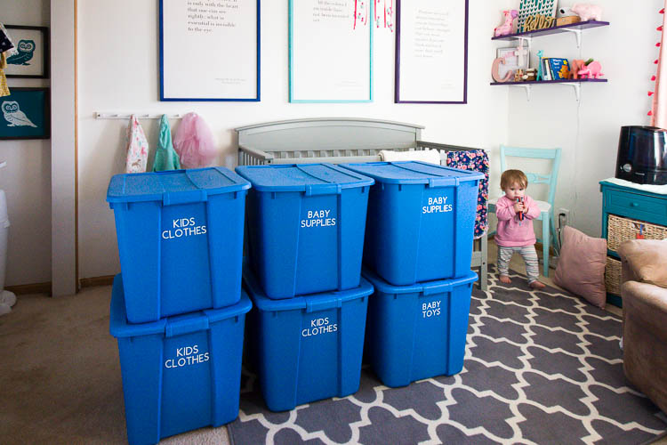 blue-storage-bins-with-labels-in-nursery