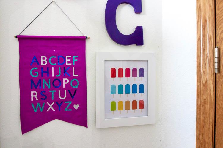 purple-fabric-banner-in-nursery