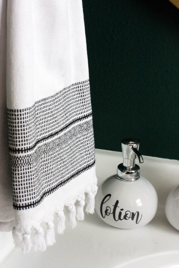 white-towel-in-green-bathroom