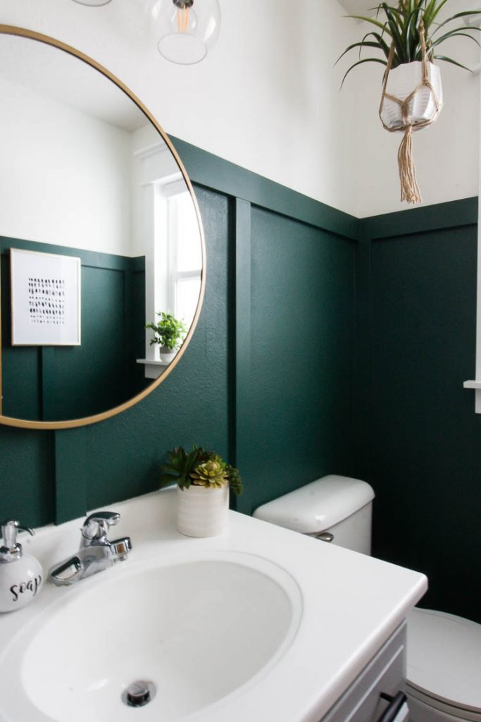 green-bathroom-with-brass-mirror
