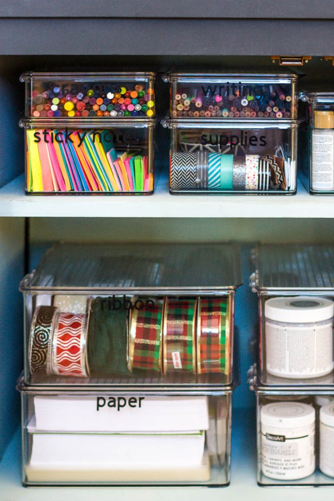 organized-craft-supplies-in-clear-containers-in-cabinet